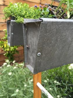 Gutter end cap attached and secured with self-drilling screws